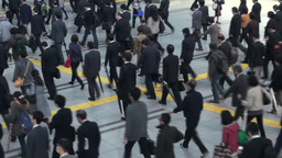 Businessmen- and women commute to work in Tokyo tr Stock Video Footage