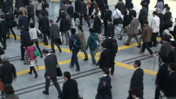 Businessmen- and women commute to work in Tokyo tr Footage
