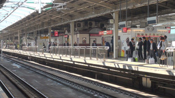 Bullet train rolls into Osaka station in Japan Stock Video Footage