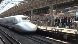Bullet train rolls into Osaka station in Japan Footage