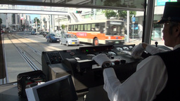 Tram driver in Hiroshima, Japan Stock Video Footage