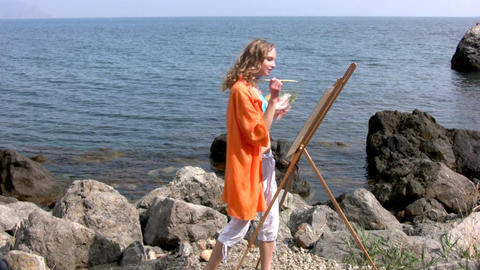 Pretty girl is drawing on easels Stock Video Footage