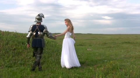 Knight and bride up the hill Stock Video Footage