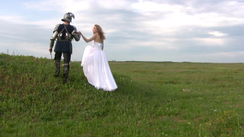 Knight and bride up the hill Footage