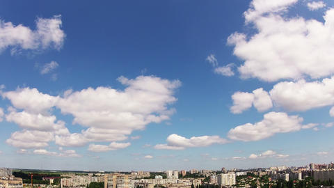Quick clouds over the city. Timelapse Footage