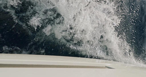 Raging stream of sea water from under boat at sunny weather, slow motion Live Action