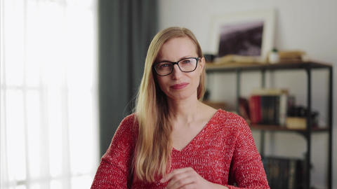 Pleasant lady taking off eyeglasses Live Action