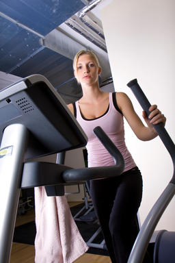 young woman training on Stairmaster Photo