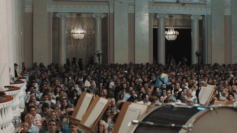 Panoramic. Crowd in classical music hall welcomes musicians with applauds Live Action