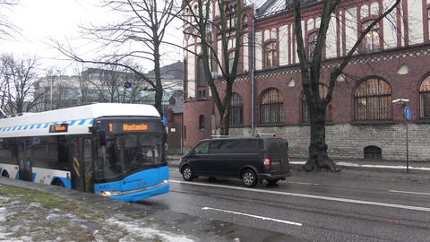 Passing vehicles in an avenue of Tallinn city Live Action