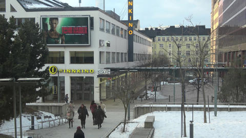 People passing outside the building of Finnkino cinema in Helsinki Live Action