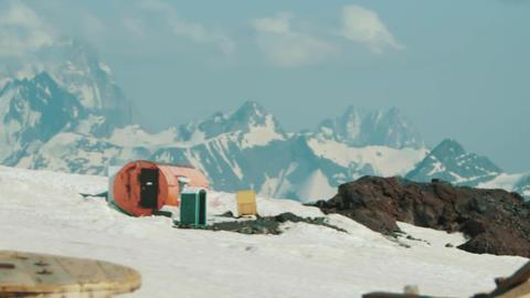 Orange metal barrel tourist shelter at hight mountain scenic landscape Live Action