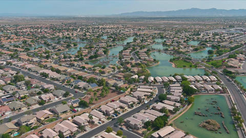 Overlooking view of a many small ponds near small town a Avondale in the desert Live Action