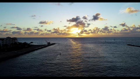 Scenic view of sunrise over florida inlet as boats travel into the atlantic ocean Live Action