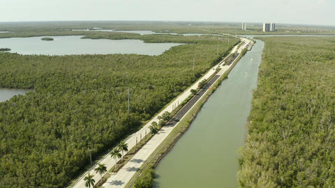 Vehicles driving on highway road in Marco Island Florida aerial Live Action