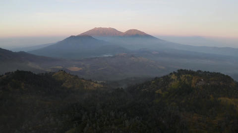 Beautiful view of sunlight on the peak of a mountain range in East Java Indonesia Live Action