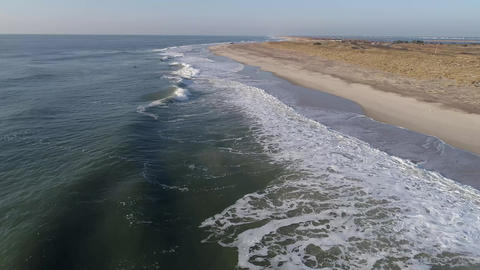 Beautiful Scenic view of barren beach along New York coastline aerial Live Action