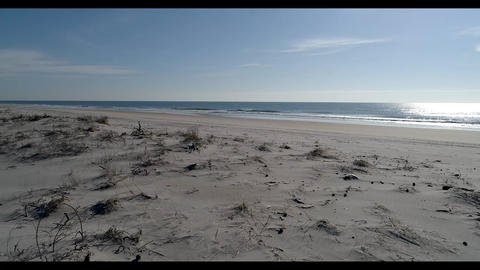 Scenic view of ocean waves rolling into empty beach Live Action