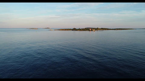 Scenic view of small group of island off the New England coast with cottages and lighthouse Live Action
