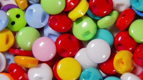 Different colored buttons made of plastic Live Action