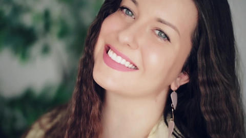 Beauty face portrait of smiling woman, perfect white teeth smile, makeup with Live Action