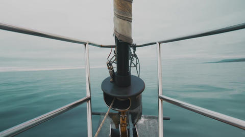 View of bow of a sailing ship sailing across Pacific Ocean in cloudy weather Live Action