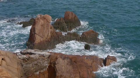 Sparkling sea surface & rock reef coastal Stock Video Footage