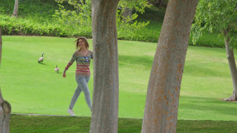 Smiling happy woman enjoying freedom after COVID-19 quarantine outdoors, summer Live Action