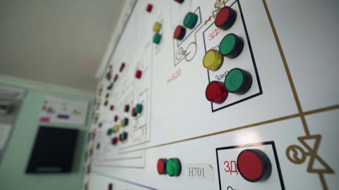 Motion down along control panel with buttons in office Live Action
