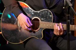 musician with black acoustic guitar ภาพถ่าย