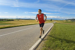 jogger running on street フォト