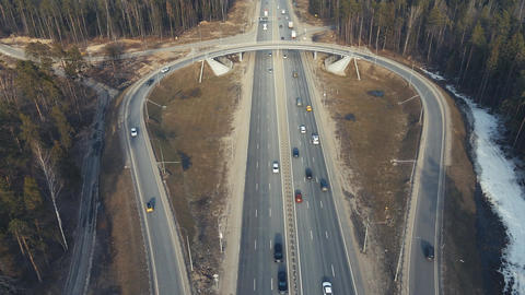 Traffic interchange with a roundabout of vehicles, view from a drone Live Action