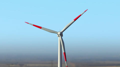 Drone approaching close to wind turbine working against summer clear sky Animation