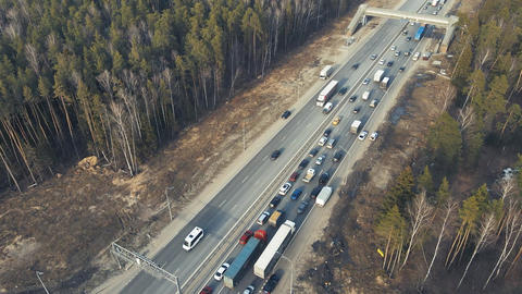 Automobile highway with direct traffic of vehicles, aerial view Live Action