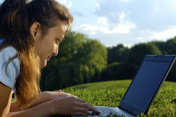 Young Woman With Laptop Outdoors ภาพถ่าย