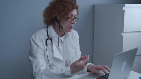 Female health care worker giving online medical treatment. Medical assistant Live Action