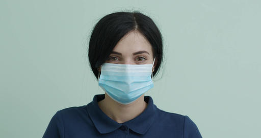 Health Protection Corona Virus Concept. Young woman in medical mask. Female Live Action