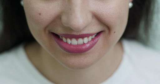 Smiling female mouth with ideal white teeth. Close up of smiling woman face with Live Action
