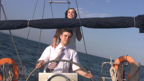 Young couple for yacht steering wheel Footage