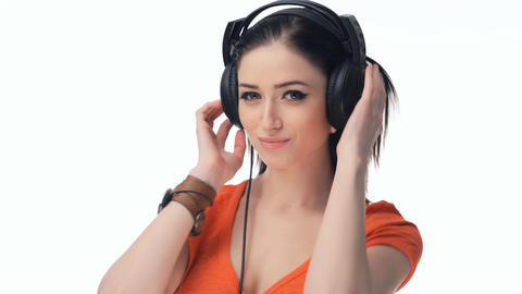 Young beautiful sexy girl listening to music on headphones Stock Video Footage