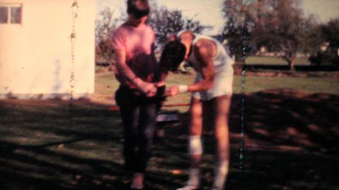 Man Adjusts Measurement While Practising Pole Vaulting 1962 Vintage 8mm film Footage