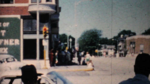 Old Cars Pass By In Urban Setting 1962 Vintage 8mm film Stock Video Footage