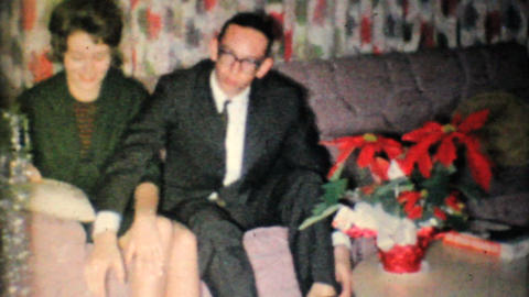 Young Man Give Girlfriend Gift At Christmas 1962 Vintage... Stock Video Footage