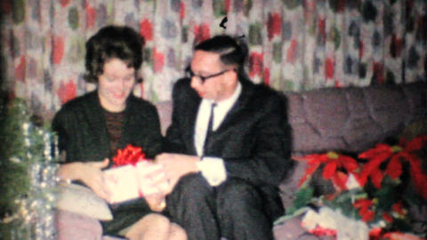 Young Man Give Girlfriend Gift At Christmas 1962 Vintage 8mm film Footage