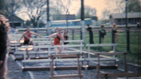 Young Men Running Hurdles Track And Field 1962 Vintage 8mm film Footage