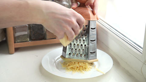 Man grating cheese for pizza, timelapse Footage