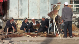 Men are selling brooms at the Kashgar Sunday Bazaa Stock Video Footage