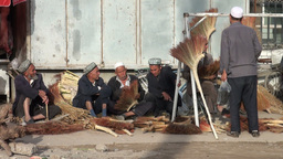 Men are selling brooms at the Kashgar Sunday Bazaa Footage