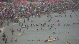 Crowded Chinese beach in summer Footage