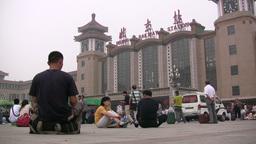 People wait in front of the Beijing Railway Statio Stock Video Footage